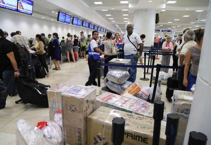 Las normas mantienen las tarifas arancelarias sobre los artículos importados por los pasajeros sin carácter comercial. (Redacción/SIPSE)
