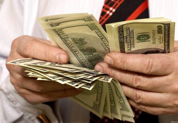 Solo unos mil 200 inmigrantes han reclamado sus fondos hasta ahora. (Archivo/AP)