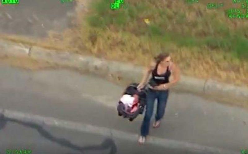 Mujer con un bebé protagoniza arriesgado intento de evadir a la policía