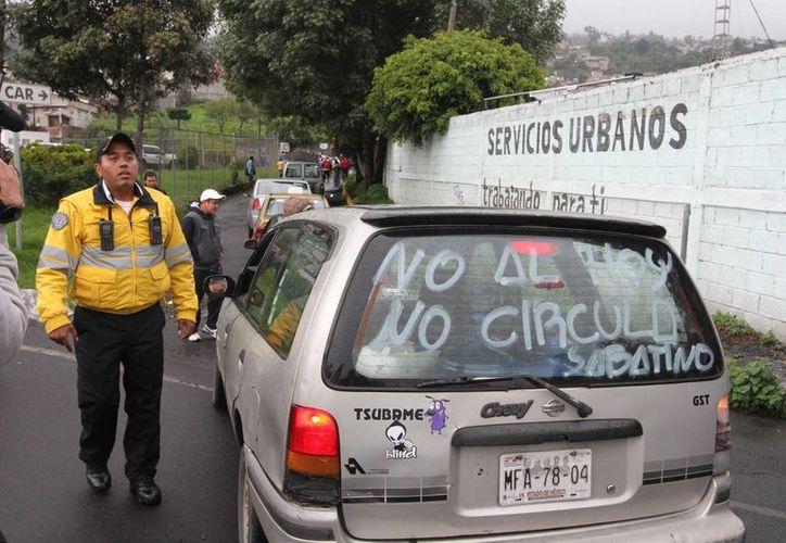 En la delegación Álvaro Obregón, en el DF, fueron detenidas 8 personas por disturbios en las protestas por el nuevo Hoy no Circula. (Notimex)