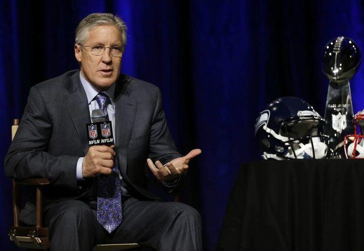 Carroll sostuvo que el gerente de los Halcones Marinos podrán resistir un aumento de sueldo a su quarterback. (Foto: AP)