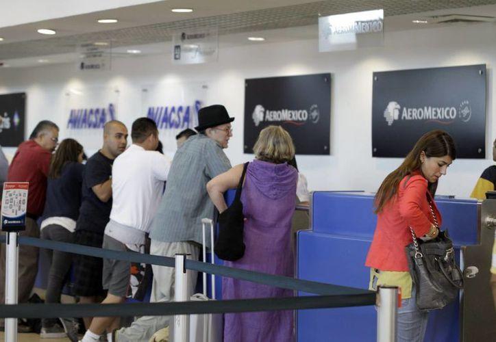Más de cuatro mil 500 pasajeros llegan al aeropuerto de Mérida en la temporada vacacional. (Milenio Novedades)