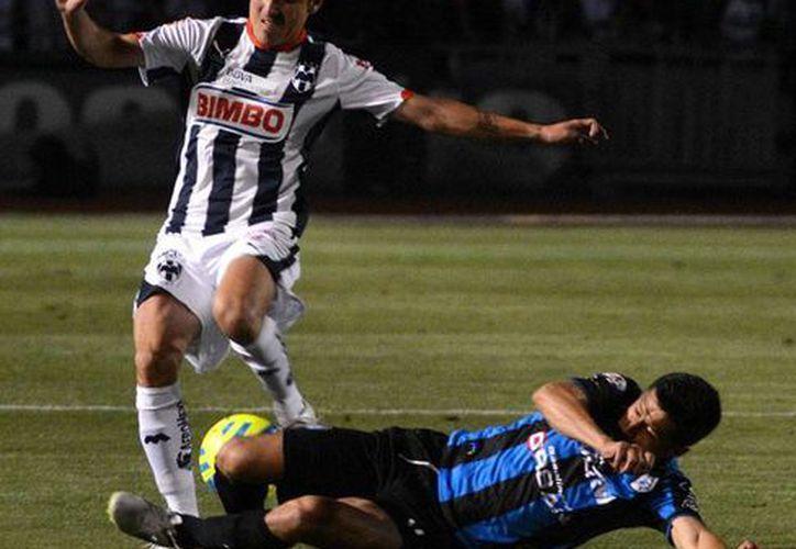 En un partido bien disputado, Monterrey derrotó a Querétaro, en el estreno de Antonio Mohamed, técnico campeón del futbol mexicano, con Rayados. (NTX)