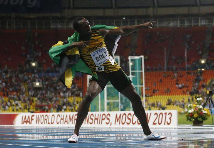 Bolt cantó victoria con un tiempo de 9.77 segundos, a 19 centésimas de la plusmarca que estableció en el Mundial de Berlín 2009. (Agencias)