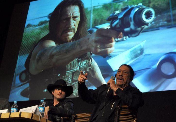 """El cineasta Robert Rodríguez y el actor Danny Trejo platican sobre su experiencia en la secuela de """"Machete kills"""", en el marco del Festival Internacional de Cine de Morelia. (Notimex)"""