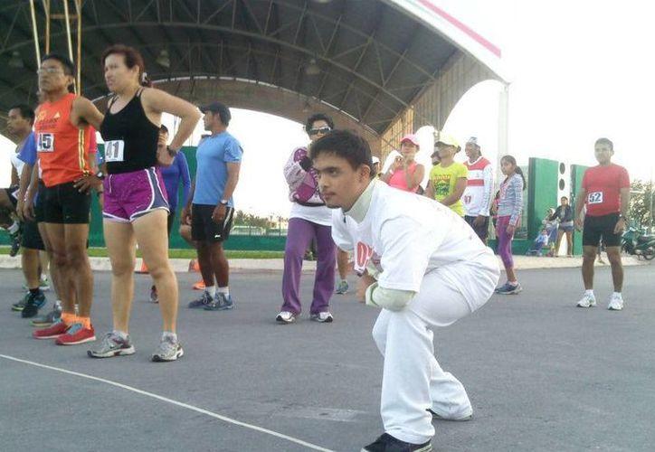 Santiago Culebro González quien padece de Síndrome de Dawn participó en la carrera. (Marco Do Castella/SIPSE)