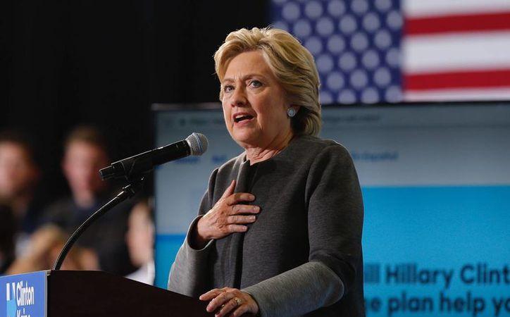 La candidata a la presidencia de los Estados Unidos por el partido Demócrata, Hillary Clinton aventaja en seis puntos a su rival republicano, Donald Trump. (EFE/Archivo)