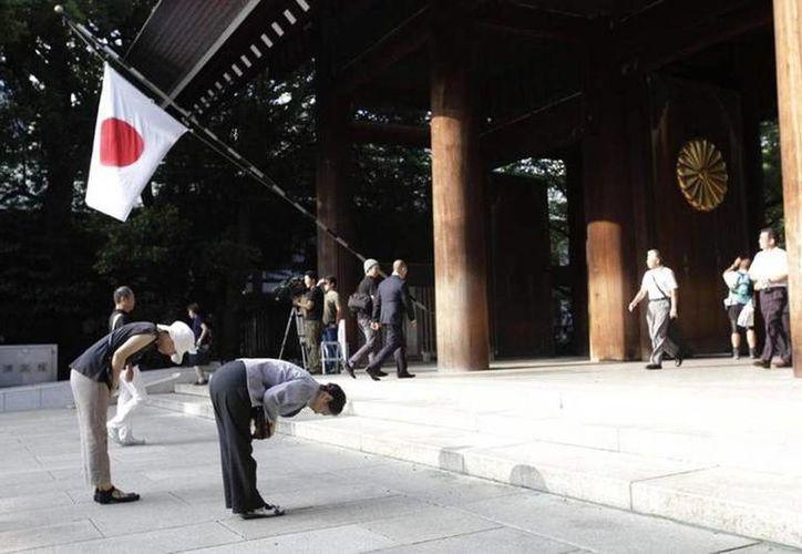 Justin Bieber se disculpó el miércoles por visitar esta semana el santuario de guerra japonés Yasukuni, diciendo que le hicieron creer que se trataba sólo de un sitio de oración. (Agencias)