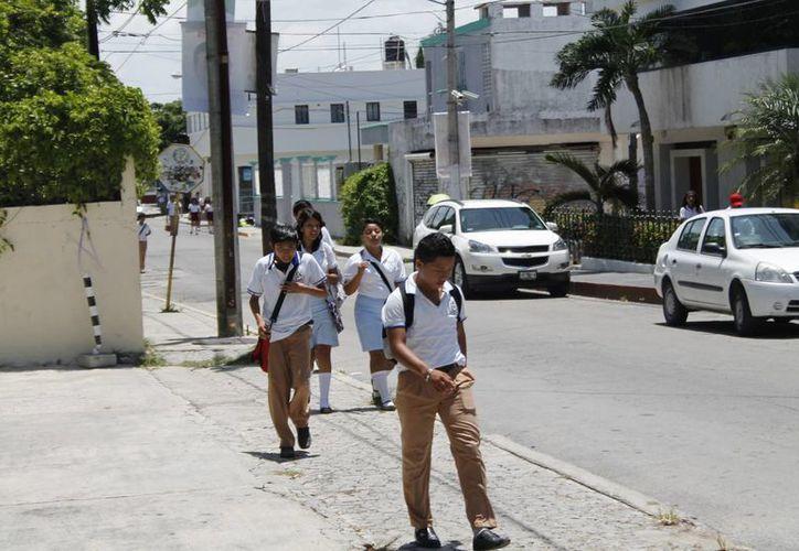 La condición económica de la familia genera deserción escolar. (Jesús Tijerina/SIPSE)