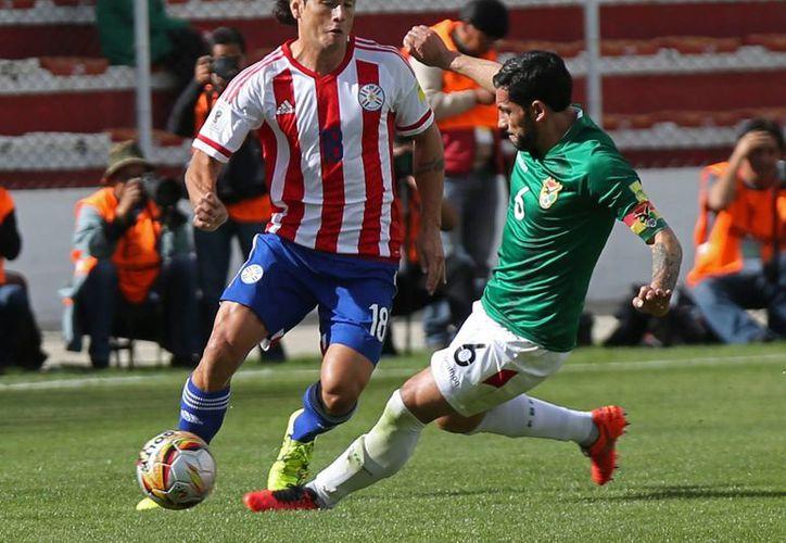 Al minuto 79 la débil Bolivia logró anotarle a la aún más débil Paraguay, en partido eliminatorio que terminó 1-0. (AP)