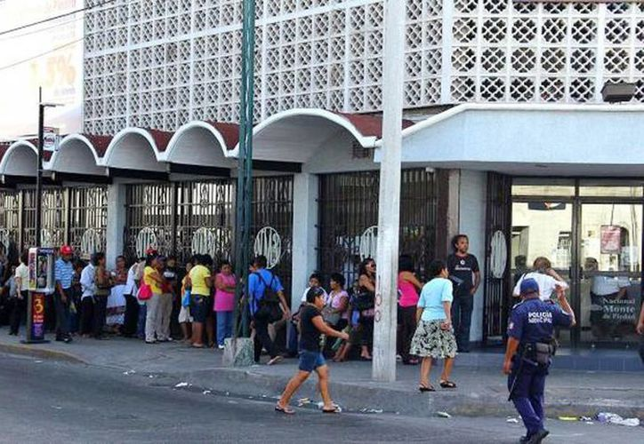 Recientemente, el Monte de Piedad bajó su tasa de interés a 3% mensual. En la imagen, una de las sucursales de esa institución en Mérida. (Archivo/SIPSE)