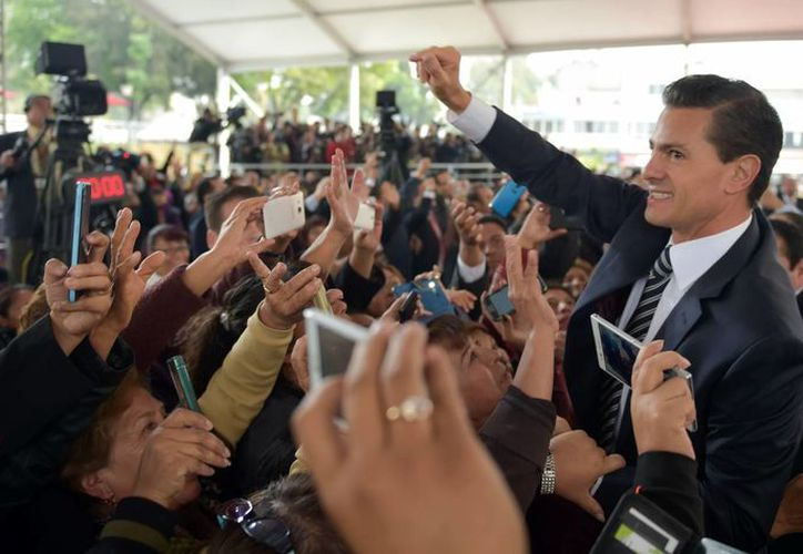 Durante el 2015, el presidente Peña Nieto anunció que además de los recursos que recibían los mexicanos con Oportunidades se darían becas para hijos de los beneficiarios. (Archivo/Notimex)