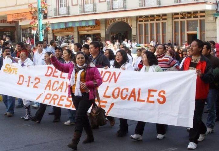 """Los maestros oaxaqueños también exigen """"la liberación inmediata"""" de los salarios retenidos. (Notimex/Foto de archivo)"""
