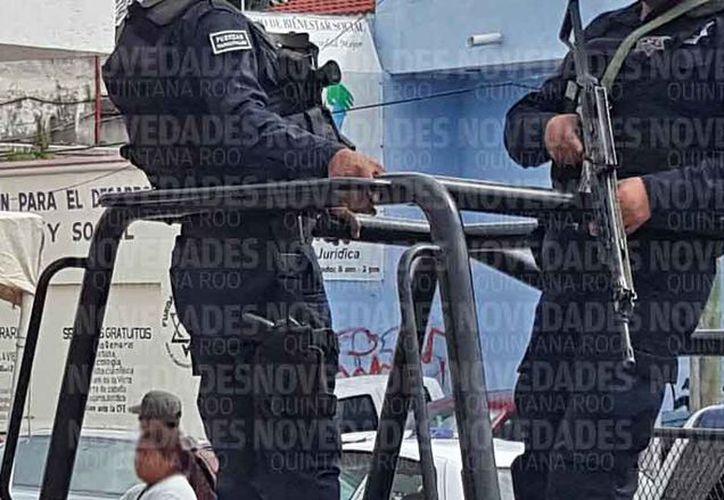 Los elementos son evaluados en habilidad de armamento y tiro policial. (Jesús Tijerina/SIPSE)