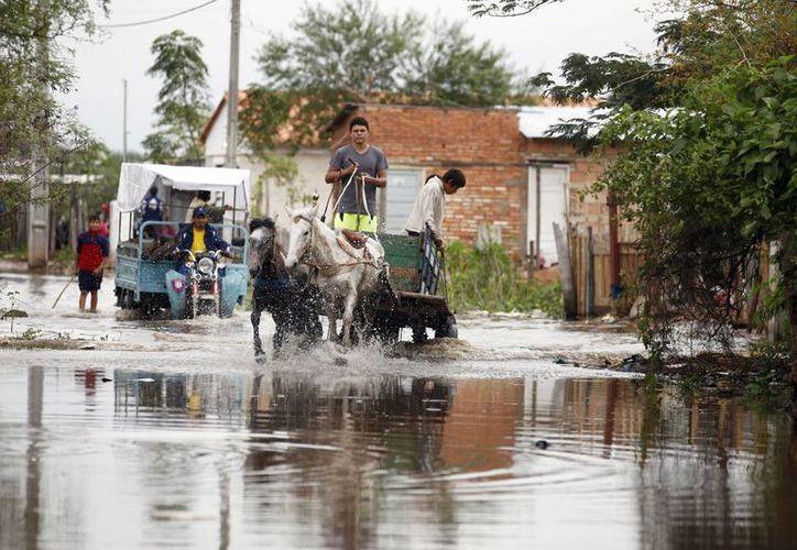 Las inundaciones han afectado a unas 12,000 familias. (Agencias)