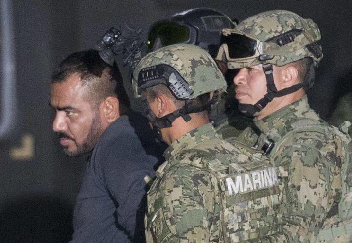 Gástelum Ávila durante su traslado al penal de máxima seguridad del Altiplano en días pasados. (AP)