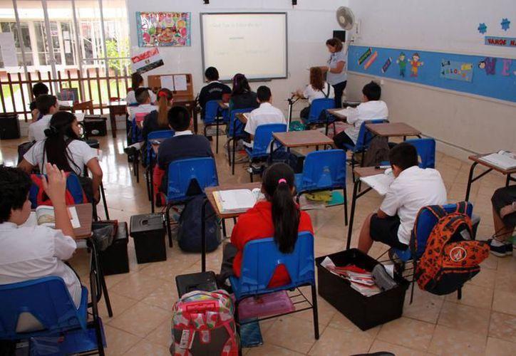 El decreto de 30 alumnos por aula fue publicado ayer por el Diario Oficial del Gobierno del Estado de Yucatán. (Milenio Yucatán)