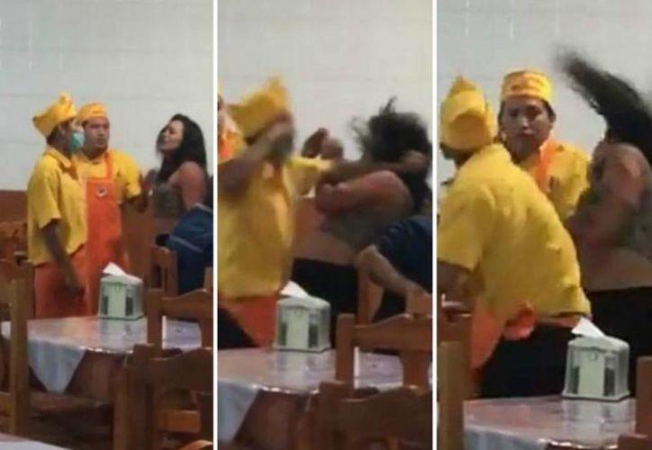 Las imágenes que fueron captadas la madrugada de este domingo, donde se ve a tres empleados de la taquería 'La Guelaguetza' forcejeando con una mujer. (Captura de pantalla)