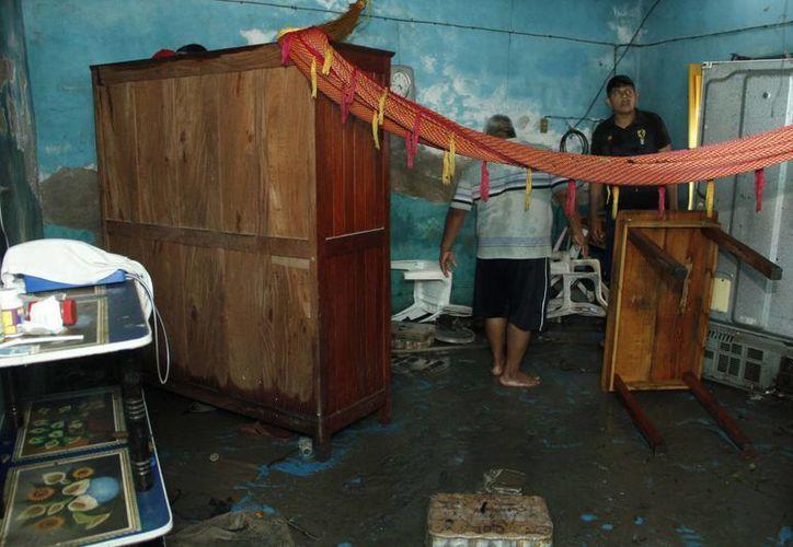 Se pretende que la construcción de viviendas sustentables ayude a mitigar los graves efectos del cambio climático, tales como los huracanes. (Notimex/Foto de contexto)