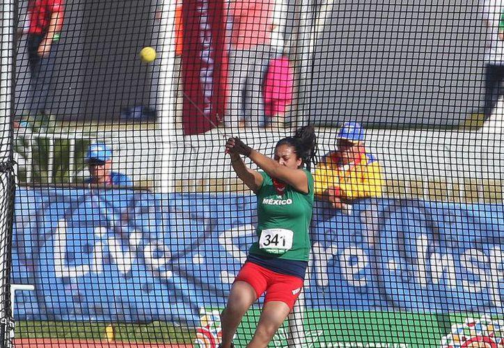 Mientras las cubanas hicieron el 1-2 en lanzamiento de martillo en los Juegos Centroamericanos, la mexicana Judith Alvarado (foto) alcanzó a quedar en sexto lugar. (conade.gob.mx)