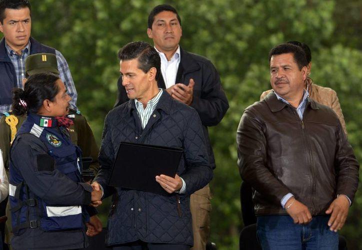 El presidente Enriuque Peña Nieto viajó este sábado a Francia junto con una comitiva. En la foto, el presidente durante la conmemoración del Día del Árbol y el inicio de la Campaña Nacional de Reforestación. (Notimex)