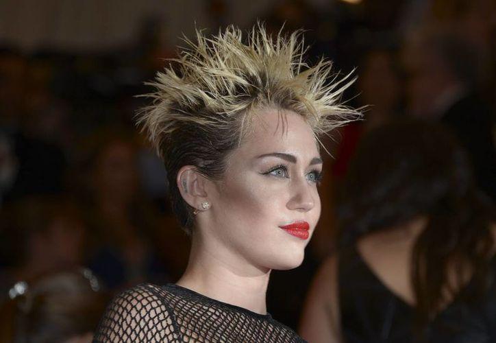 La popularidad de Miley Cyrus subió como la espuma durante 2013, sobre todo debido a escándalos. (EFE)