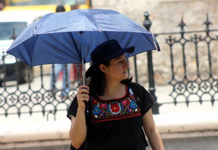 De acuerdo con los pronósticos, se esperan algunas lluvias para Yucatán y se mantendrán las temperaturas de 33 a 36 grados. (SIPSE)