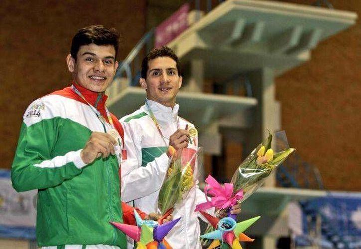 Rommel Pacheco y Rodrigo Diego con sus medallas de oro, en el Festival Deportivo Panamericano. (Twitter/@Rommel_Pacheco)