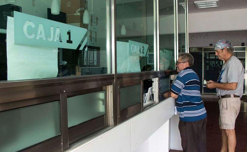 Las personas podrán pagar el impuesto en las cajas del Palacio Municipal de Cozumel. (Foto: Redacción)