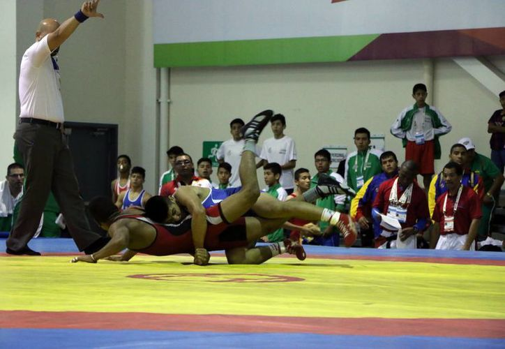 México ocupa el tercer peldaño del medallero e ncuanto a luchas asociadas, en los Juegos Deportivos Escolares Centroamericanos y del Caribe (Jedecac). (José Acosta/SIPSE)