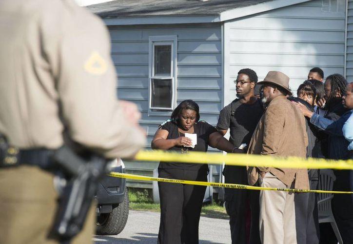 La casa ubicada en Princess Anne, donde la policía dijo haber encontrado ocho personas muertas: siete niños y un adulto. (Foto: AP)