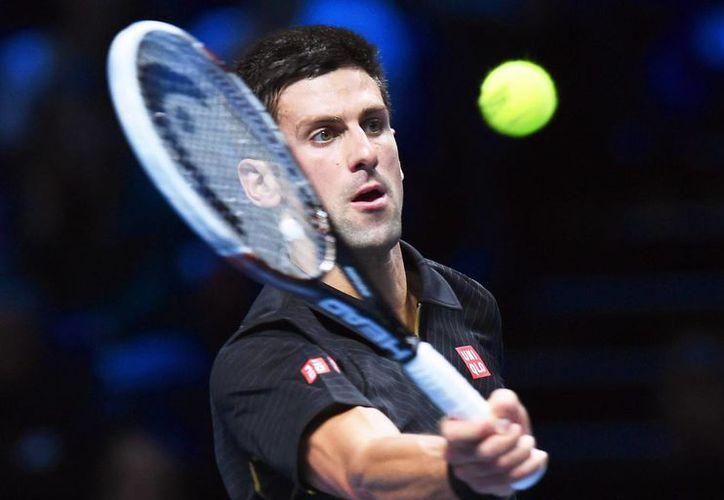 Djokovic ganó el primer set ante Nishikori sin siquiera despeinarse. (EFE)