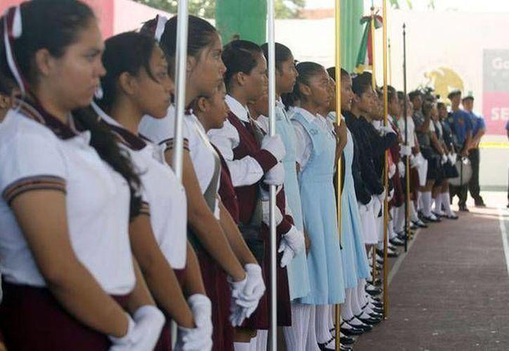 El objetivo es que los alumnos entonen los himnos en los actos cívicos y fechas que marcan la historia de Yucatán y México. (Foto de contexto. Archivo/SIPSE)