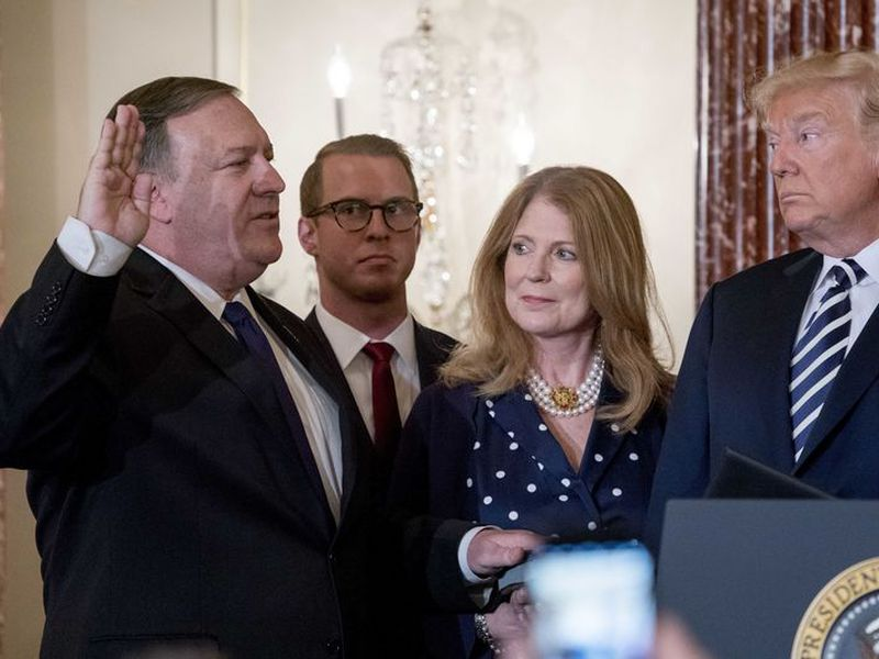 President Donald Trump looks on as Vice President Mike Pence administers a ceremonial swearing in to Secretary of State Mike Pompeo at the State Department. (AP)
