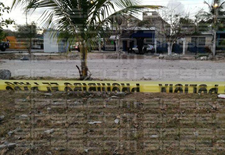 Una de las víctimas podría ser un elemento de la policía municipal. (Orville Peralta/ SIPSE)