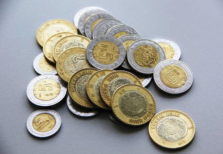 El peso llegó a su peor nivel en dos años y medio respecto a la cotización del dólar. (Archivo/Notimex)