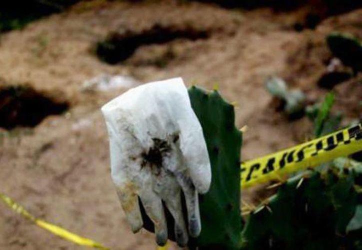 En las fosas clandestinas fueron halladas la tarde de este miércoles, 11 cuerpos en Hidalgo, Michoacán. (Archivo/SIPSE)