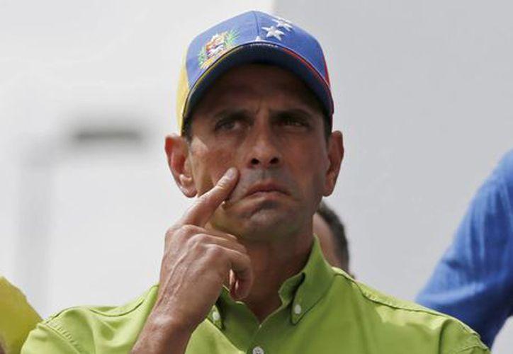 La jornada de protesta pacífica, en la que los opositores se concentraron en plazas, fue convocada esta semana por Capriles. (Agencias)