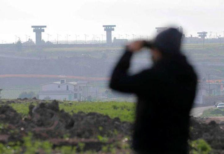 Tres exfuncionarios acusados de facilitar la fuga de Joaquín 'El Chapo' Guzmán quedaron formalmente presos, todos en el penal del Altiplano, de donde se fugó el narcotraficante. (Milenio Digital)