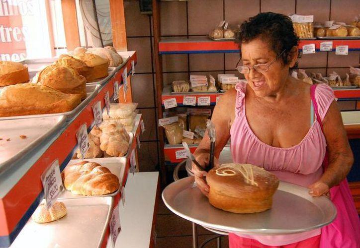 Las lluvias motivan a las familias a consumir más pan. (Milenio Novedades)