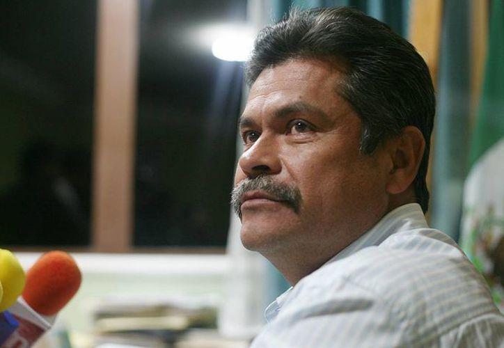 Juan José Ortega Madrigal fue detenido en Apatzingán, durante una movilización reciente por personal de la PGJE.. (Gustavo Aguado/revoluciontrespuntocero.com)