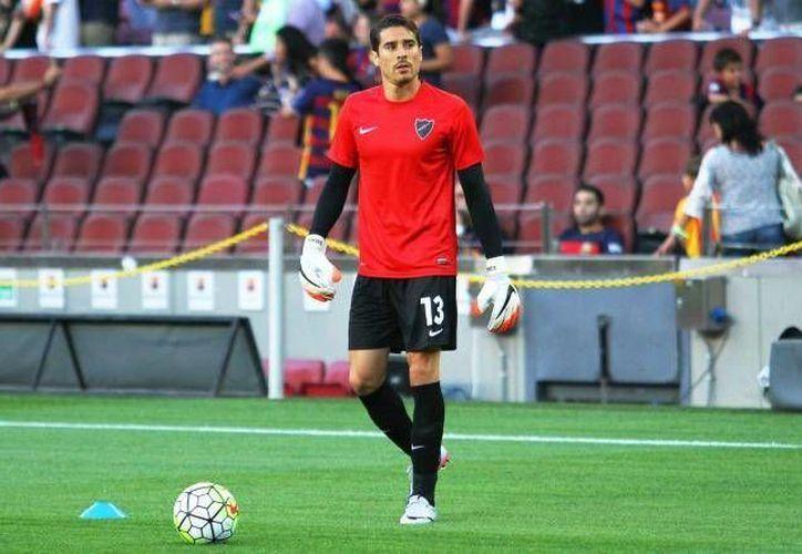 Tras un año y siete meses de estar con el Málaga, este sábado el mexicano Gullermo Ochoa debutó en la Liga de España al entrar de cambio por su compañero, Carlos Kameni. (Archivo Mexsport)
