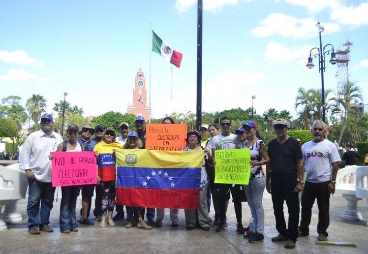 Venezolanos en Mérida criticaron al régimen de Nicolás Maduro. (Fotos: Daniel Sandoval/Milenio Novedades)