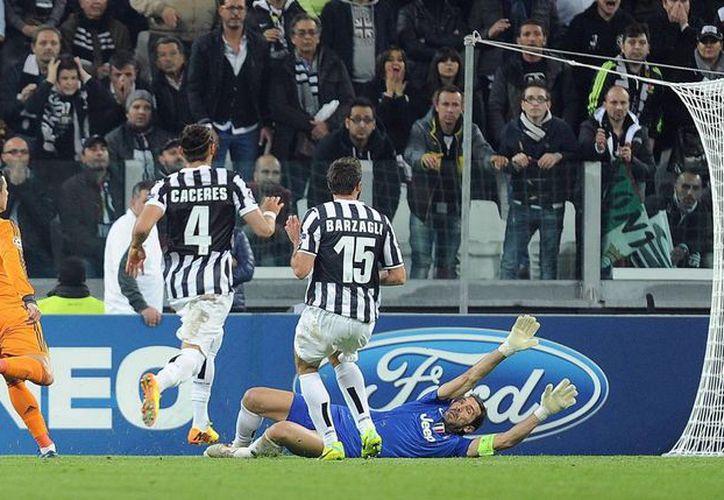 En el minuto 52, con 1-0 en contra en el Juventus Stadium de Turín, el astro portugués batió a Gianluigi Buffon y firmó el 1-1. (EFE)