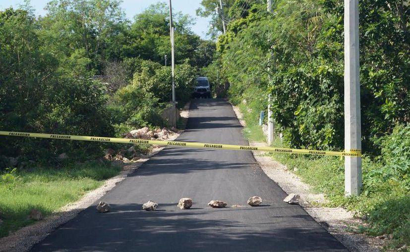 Al final de la calle, 'Chuco', como era conocido por sus vecinos decidió colgarse de un árbol, en Acanceh. (Sipse)