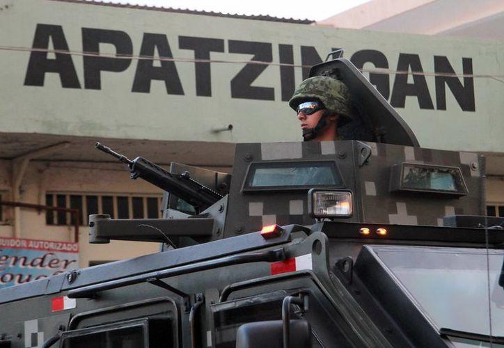 Los peces gordos arrestados en Apatzingán son: Faustino Andrade González, de 46 años, familiar de 'El Chayo', así como Mario Loya Contreras, de 40 años. (Notimex/Foto de contexto)