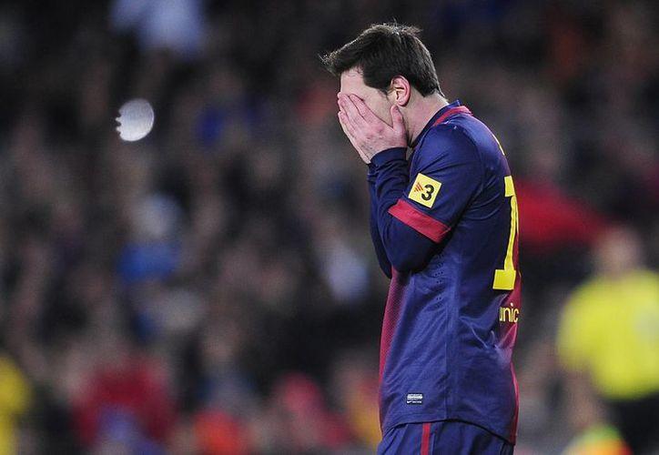 Sin Messi en el entrenamiento del miércoles aludiendo 'fiebre y malestar general', el Barsa despertó un día después de la derrota buscando saber quién es.  (Agencias)