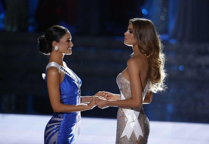 Ariadna Gutiérrez (derecha), Miss Colombia, se mostró sin resentimientos y aseguró que 'todo pasa por una razón'. (Archivo AP)