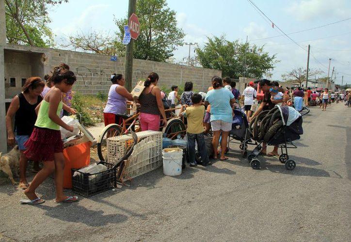 """La campaña """"Recicla por tu bienestar"""" aplicada en colonias ha ayudado a bajar los índices de dengue. (Sipse)"""