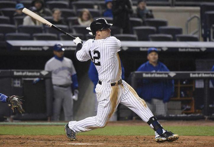 Chase Headley, con un hit en el octavo inning, contribuyó a la victoria de Yanquis de Nueva York.  (Foto: AP)